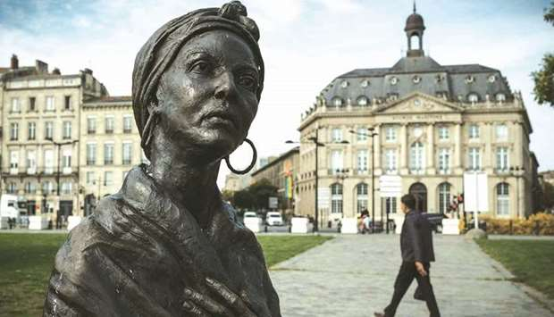 This photograph taken yesterday in Bordeaux shows a statue depicting Modeste Testas, a slave who was