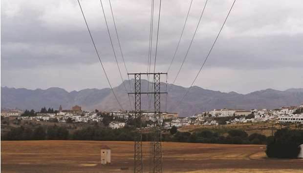 Power lines connecting pylons of high-tension electricity are seen at a substation on the outskirts