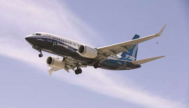 A Boeing 737 MAX lands after a test flight at Boeing Field in Seattle, Washington (file). The planem
