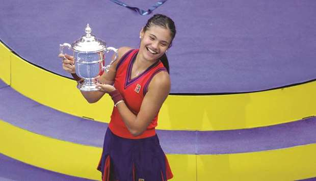 Britain's Emma Raducanu celebrates with the trophy after winning the 2021 US Open women's final agai