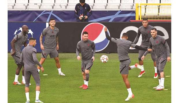 Paris Saint-Germain's Lionel Messi (centre) takes part in a training session with teammates at the J