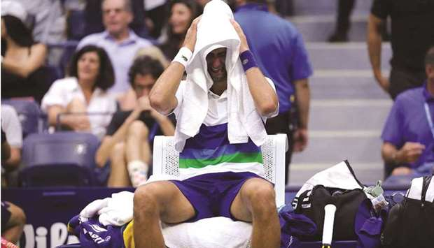 Novak Djokovic of Serbia can't hold back his tears after the loss to Daniil Medvedev (not pictured)