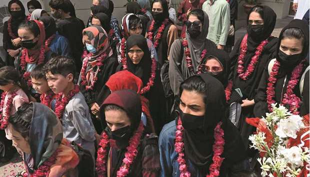 Members of Afghanistan's national girls football team are seen on their arrival at the Pakistan Foot