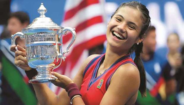 Emma Raducanu of Great Britain celebrates with the US Open trophy after winning her maiden Grand Sla