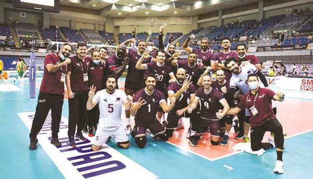 Qatar players celebrate after their win over Australia at the Asian Volleyball Championship in Chiba