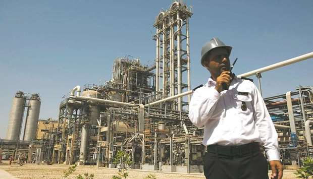 A security person stands in front of the Mahshahr petrochemical plant in Khuzestan province, some 10