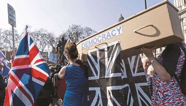 (File photo) Pro-Brexit demonstrators carry a coffin representing the death of democracy as proteste