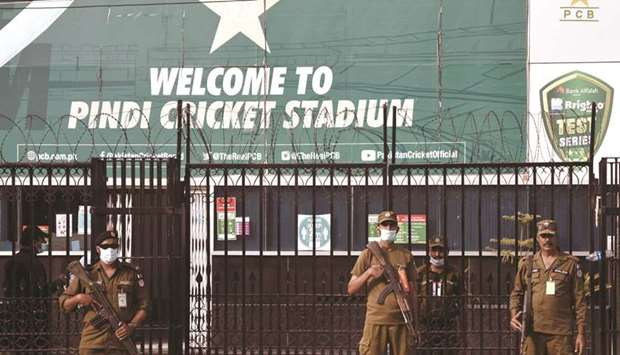 Police officers stand guard outside Rawalpindi Cricket Stadium after New Zealand cricket team pull o