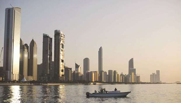 A general view of the city skyline at sunset from Dhow Harbour in Abu Dhabi (file). The $110bn state