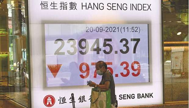 An electronic board shows the Hang Seng index after it tumbled more than 4% in the morning session i