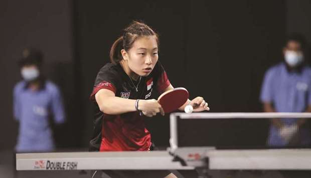 Singapore's Zhang Wanling in action during her match against Iran's Shima Safaei in qualifying round