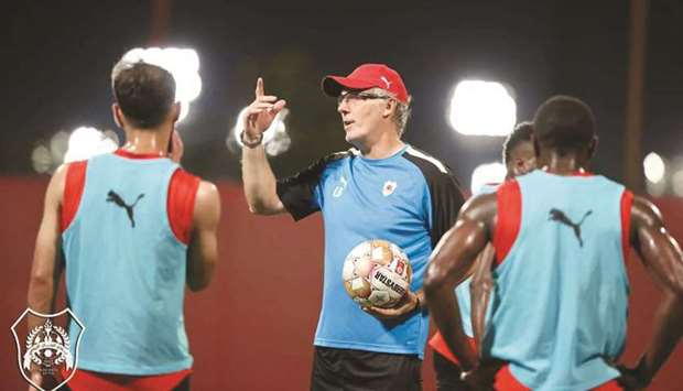 Al Rayyan coach Laurent Blanc talks to his players during a training session yesterday.