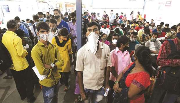 People wait to receive a Covid-19 vaccine in a hospital in Mumbai yesterday.