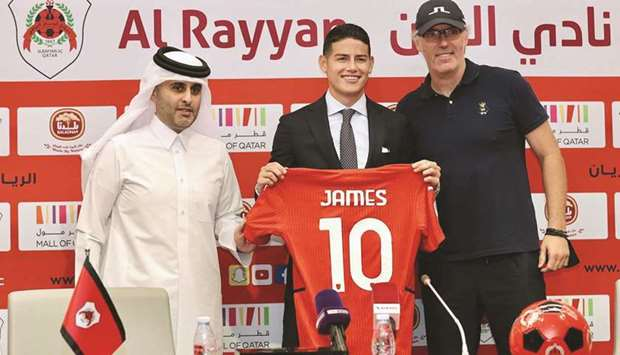 Colombia's James Rodriguez (centre) poses with club's President Sheikh Ali bin Saud al-Thani and coa