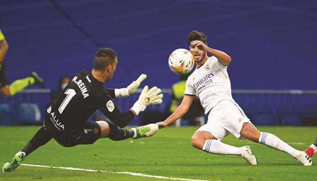 Real Madrid's Spanish midfielder Marco Asensio (right) scores his team's third goal during the Spani