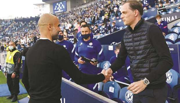 Manchester City manager Pep Guardiola (left) with Chelsea manager Thomas Tuchel. (Reuters)