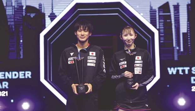 Japan's Shunsuke Togami (left) and Hina Hayata celebrate with the trophy after winning the mixed dou