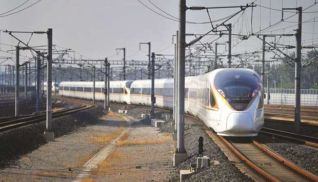 A bullet train, travelling from Beijing to Shanghai, arrives at Jinan West Station in Shandong  Prov