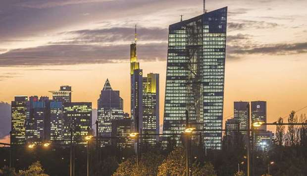 The European Central Bank building (right) is illuminated while dominating the skyline of Frankfurt