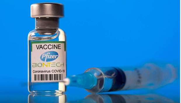 FILE PHOTO: A vial labelled with the Pfizer-BioNTech coronavirus disease (COVID-19) vaccine is seen