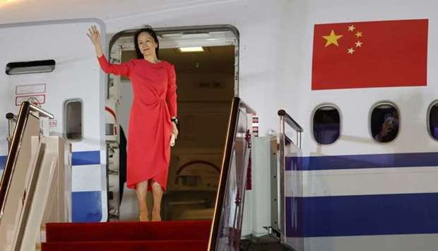 Huawei Technologies Chief Financial Officer Meng Wanzhou waves as she steps out of a charter plane a