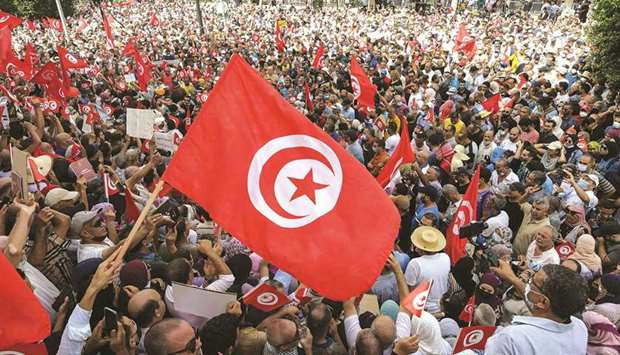 Demonstrators chant slogans during a protest in Tunisia's capital Tunis yesterday.