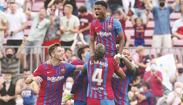 Barcelona's Ansu Fati celebrates scoring their third goal with teammates against Levante at the Camp