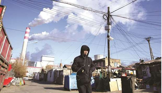 A man walks near a coal-fired power plant in Harbin, Heilongjiang province (file). China is in the g