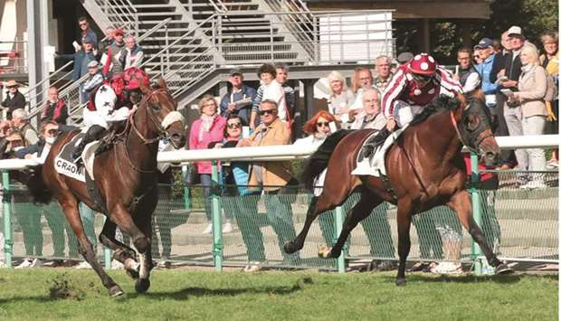 Jockey Mickael Barzalona rides Pearl Tree (right) to victory in the Prix EJS Lesieur, a Claimer at C