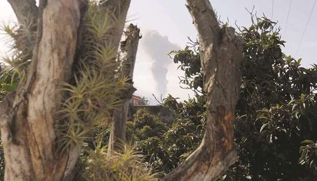 A column of smoke is seen as the Cumbre Vieja volcano resumes activity after a short pause.