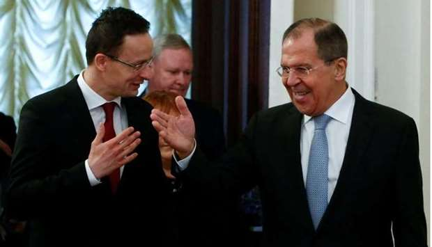 Russian Foreign Minister Sergei Lavrov and his Hungarian counterpart Peter Szijjarto enter a hall du