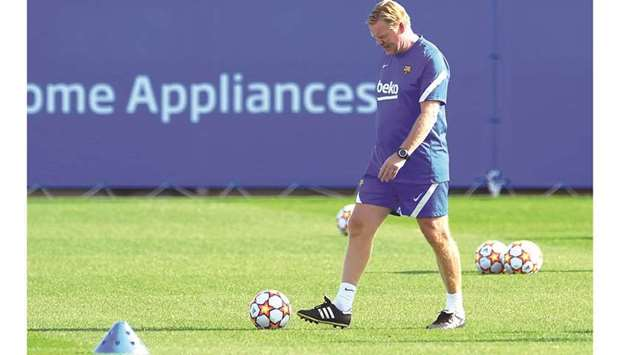 Barcelona's Dutch coach Ronald Koeman during a training session at the Joan Gamper training ground i
