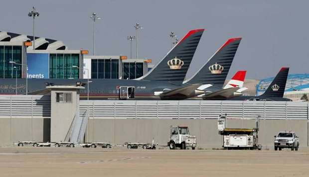Planes that belong to the Royal Jordanian Airlines and other companies are parked at the Queen Alia