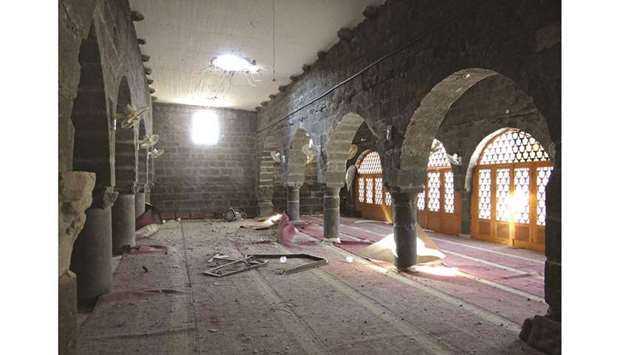 A view of the crater left after a reported shelling by Syrian government forces on the Omari mosque