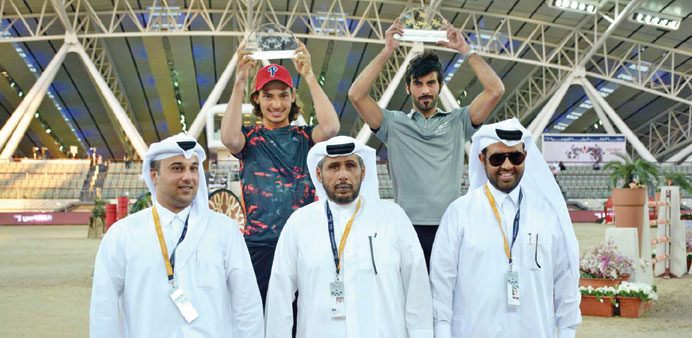 Champion Faleh Nasser Saleh Bughenaim of Al Shaqab and runner-up Bilal Bassam Shawqi al-Kharraz pose