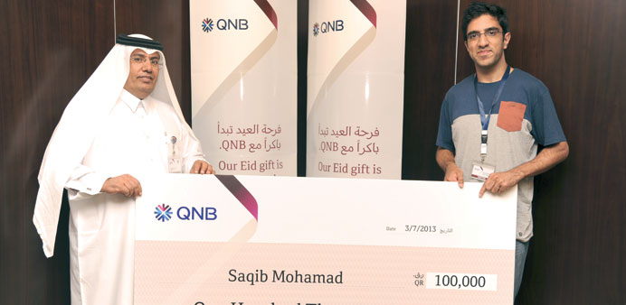 Saqib Mohamed with a QNB official.