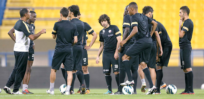 Fahad Thani speaking to his players during a training session on the eve of their friendly match aga