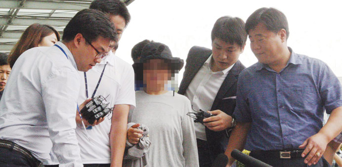 Kwon Yun-ja (centre) being arrested at an undisclosed location in South Korea on embezzlement charge