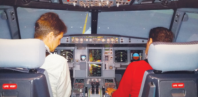 Turkish Airlines pilots honing their flying skills inside a Boeing simulator at the carrier's Flight