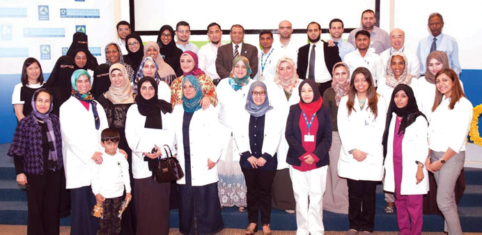 Dr Manal Zaidan with staff members during the celebration.