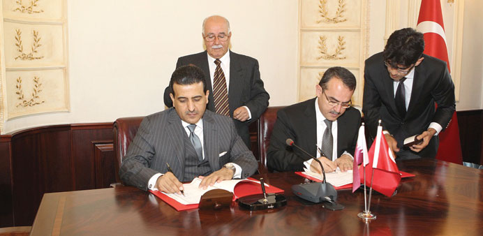 HE Dr al-Marri (left) and Ergoan signing the MoU.