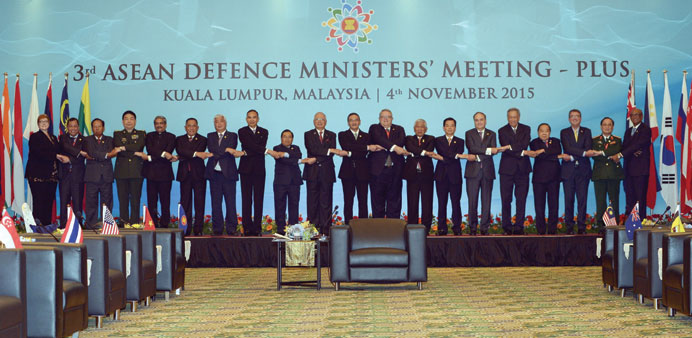 Officials pose for pictures during the Association of Southeast Asian Nations (Asean) Defence Minist
