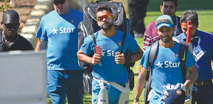 India's Virat Kohli (centre) and Ajinkya Rahane leave the nets after a training session in Perth. (