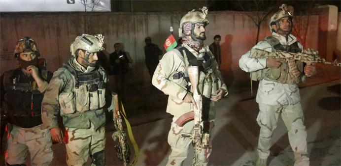Members of Afghan Crisis Response Unit (CRU) arrive at the site of a Taliban attack