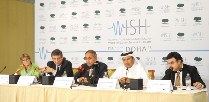 Lord Darzi, flanked by other speakers, at the press conference.
