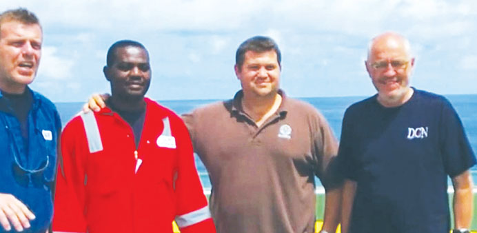 Harrison Odjegba Okene with divers of DCN Diving after they rescued him from his tug boat that sank.
