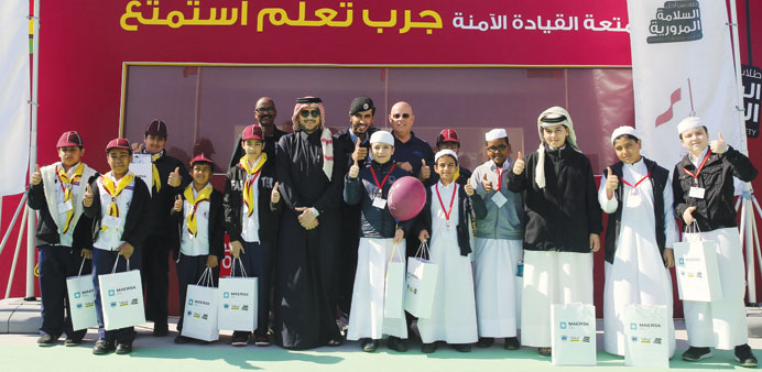 A group of students in front of the MOQ pavilion at Darb Al Saai.
