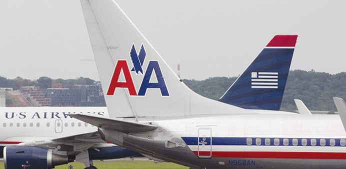 AMR Group's American Airlines and US Air aircraft pass each other. The airlines are seen merging thi