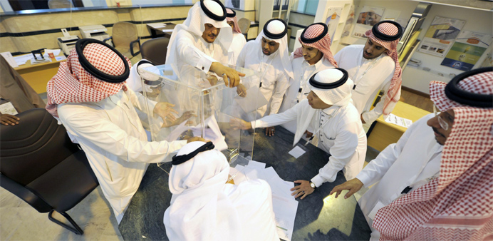 Saudi election officials prepare to count votes at the end of the municipal elections