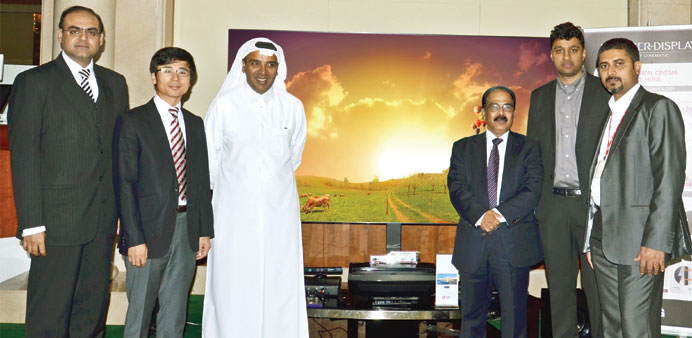 LG's Kim and Video Home's Suleiman and Rappai are seen with other officials at the event.